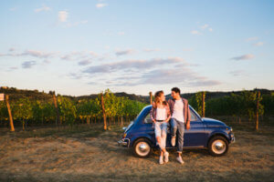 Beautiful couple trip in the country with a vintage car